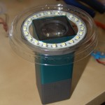 Mount the LED ring with case onto the camera, place the yoghurt lid on top and mark the outer edge of the case, as well as the outer edges of the camera.
