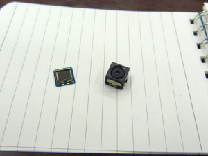 Toshiba's tiny LightField camera module for smartphones, with (right) and without (left) lens (photo: IDG News Service)